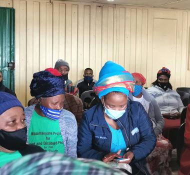 Dr Nomafrench Mbombo registers an elderly resident for the vaccine.
