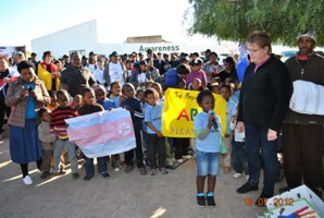 One of the children at the Pikanania creche performing the national anthem.