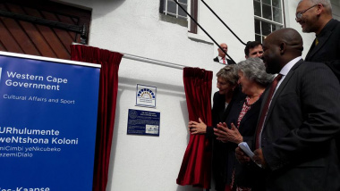 Minister Anroux Marais unveils the Provincial Heritage Site plaque while Heritage Western Cape's Chairperson, Dr Antonia Malan, HWC's CEO, Dr Mxolisi Dlamuka, CoCT Cllr Stuart Diamond and Acting Head of Department, Dr Lyndon Bouah look on