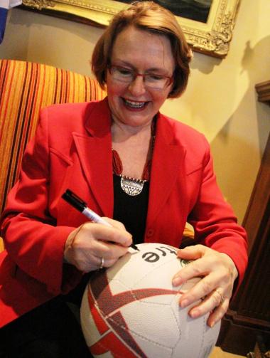 Premier Helen Zille signs a ball.