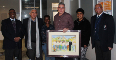 Prof. Odendaal accepting a token of appreciation for service to sport.