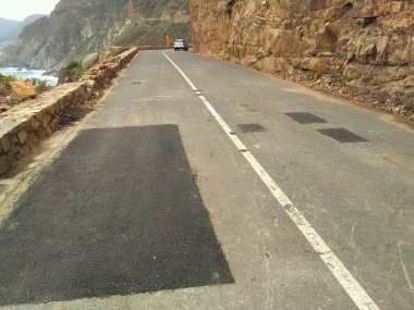 Repairs have been done to the road surface.