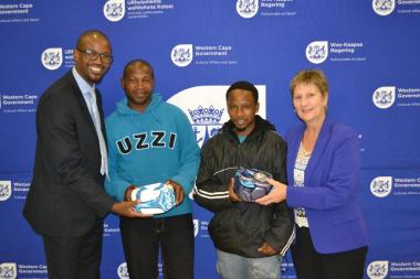 Representatives from Kleinmond Football Club received equipment from Minister Anroux Marais