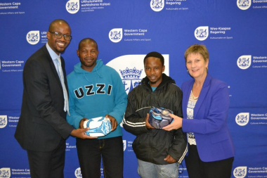 Representatives from Kleinmond Football Club received equipment from Minister Anroux Marais