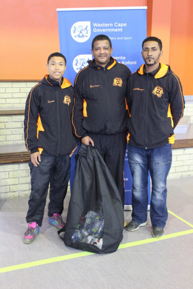 Representatives from Pella Sporting Football Club with their equipment