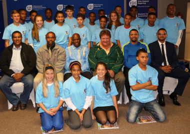 Representatives of DCAS, the West Coast Sport Council and the academy pose with athletes.