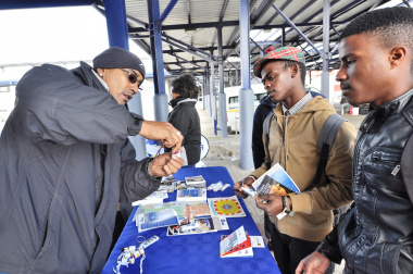 Road Safety Officer Anthony September engages with passengers at the Gugulethu taxi rank.