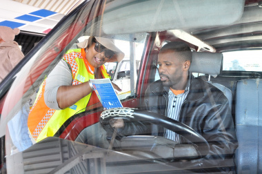 Road safety officer Nonkosi Peter speaks to taxi driver Xolani Tiwayi.