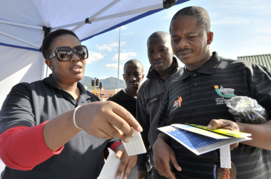 Road safety Officer Notsikelelo Nqgabuko demonstrates how to use drug testing equipment.