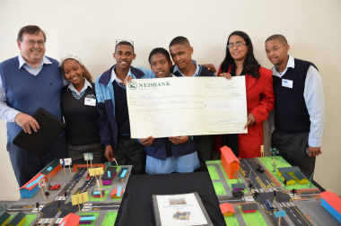 Minister Grant congratulates Parkdene Secondary School learners, the winners of the PET competition.