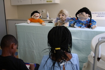 Occupational therapists host a puppet show in Ward D2 to teach children and their parents about the role OTs play.
