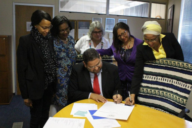 Signing of the pledge by HOD Brent Walters and female SMS members