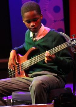 Simlindile Bistoli from the Langa School's Music Project on guitar