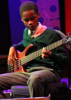 Simlindile Bistoli from the Langa School's Music Project on guitar