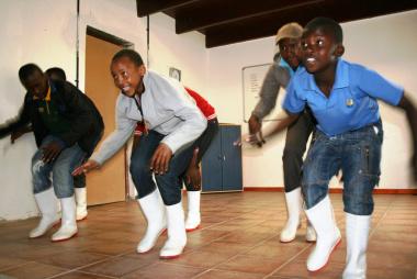 Simphiwe Sabanga, Dennis Masela, Patrick Nkosi and Justice Mahlaba showing their Gum Boot dancing skills.