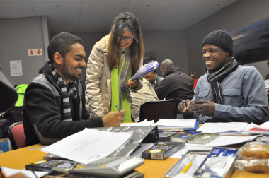 Skills development facilitator Bridgette Whyte interacts with Shuaib Julius and Lehlohonolo Taudi (from Eerste River).