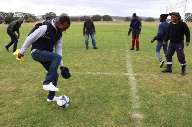 Soccer players warm up before competing at the Overberg BTG