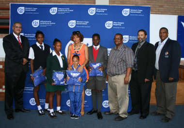 Some of the athletes who received Ministerial Bursaries pose with dignataries.