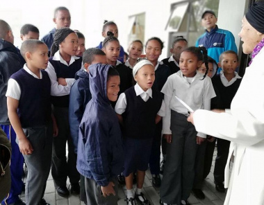 Song performance by Tesselaarsdal Primary School learners at the official opening of the library