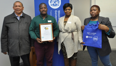 Stanley Amsterdam (Treasurer of SANTACO Western Cape) with Mcebisi Dyasi, Buyelwa Mboya and Zikhona Sikatele of the Department of Transport and Public Works.
