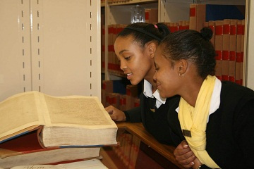 Students reading books at the archives