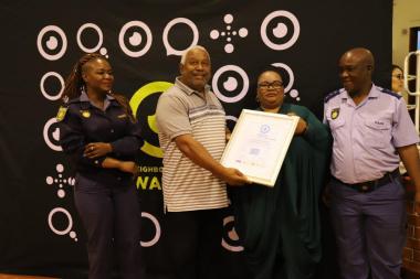 Sunnyside Gleemor NHW receiving their accreditation certificate.