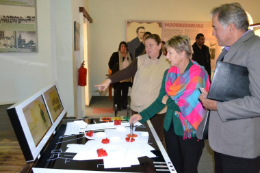 Tania le Roux shows Minister Marais the interactive exhibition at the Wheat Industry museum