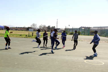 Team Western Game players practising their Kgati skills