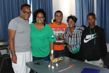 Teamwork makes dreamwork! A group of students who built the tallest structure in the CCDI session using only spaghetti, marshmallows and rubber bands