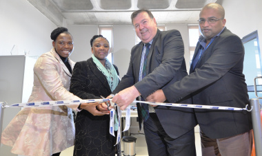 Thandeka Gqada (Member of Parliament), Dr Nomafrench Mbombo, Minister Donald Grant and Dr Michael Phillips (Head of Khayelitsha Eastern Substructure Office) at the ribbon-cutting ceremony.