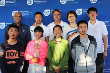 The Chinese delegation, with Jixian Wang, winner of the Optimist B Fleet class, Mr Bennett Bailey from DCAS and Craig Lesley from SA Sailing