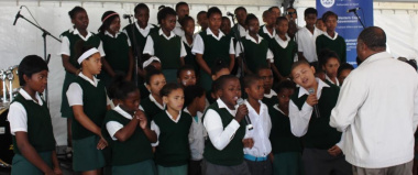 """The Choir from Kosie De Wet Primary School singing """"One Call Away""""."""