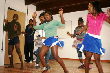 The dancers performing cultural moves during a workshop.
