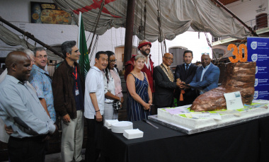The Dias Museum's 30th birthday cake was shaped as boot to symbolise the history of the famous Postal Tree on the museum grounds.