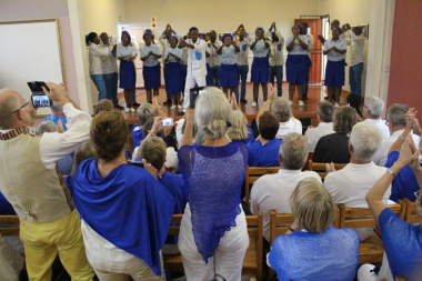 The Lwandle community choir entertaining their audience and their audience enthusiastically participating