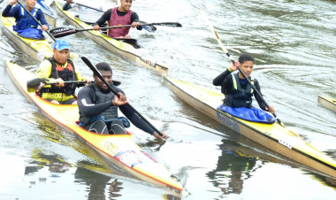 The Minister of Cultural Affairs and Sport, Dr Ivan Meyer paddles with the  Berg River Canoe Marathon Development teams on Sunday.