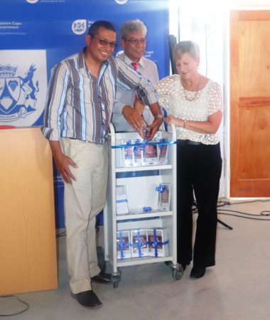 The ribbon cutting ceremony. From left Councillor Karriem Adams, Minister Anroux Marais and Mayor Barnito Klaasen