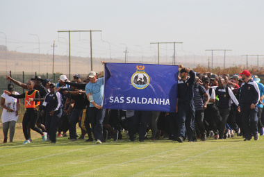 The Saldanha Naval Base officials brought the most energy to their march around the field, singing and dancing as they went