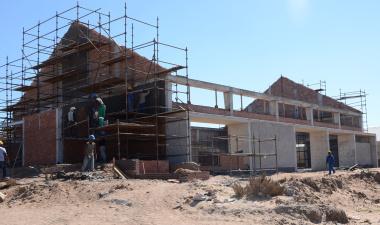 The school hall under construction.