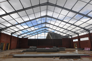 The school hall under construction.