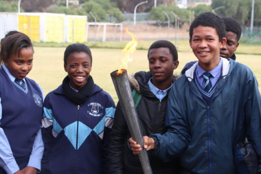 The symbolic torch reminds learners about the Olympic values