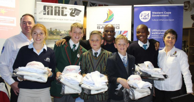 The team receiving their kits with Thabo Tutu, Andre Wollheim, and Bev le Sueur