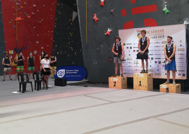 The top three finishers in the men's category take their places on the podium at the DCAS-supported IFSC Continental Climbing Championship on Sunday.
