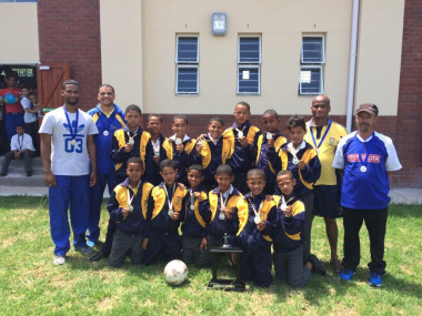 The u12 soccer team basking in the glory of their achievement
