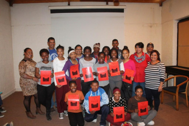 The winners with their certificates at the end of the Amazing Race