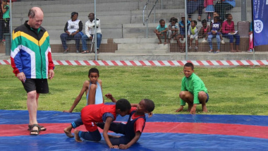 The wrestling demonstration aimed to set straight the misconceptions about the sport.