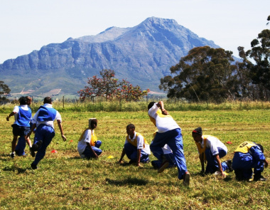 The youth participating in Dibele on the camp sports field