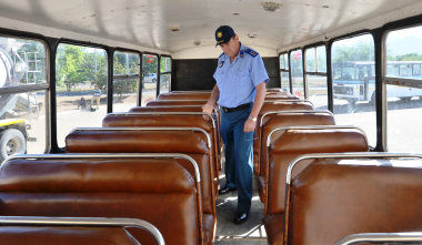 Traffic Inspector Jacques Mostert inspects the seats of a bus.