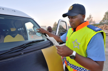Traffic Officer Nonwabisi Soswana inspects a minibus taxi for roadworthiness.