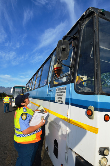 Traffic Officer Wendy Sampson inspects a bus.